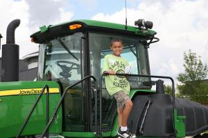 Farm Camp_boy on tractor_0